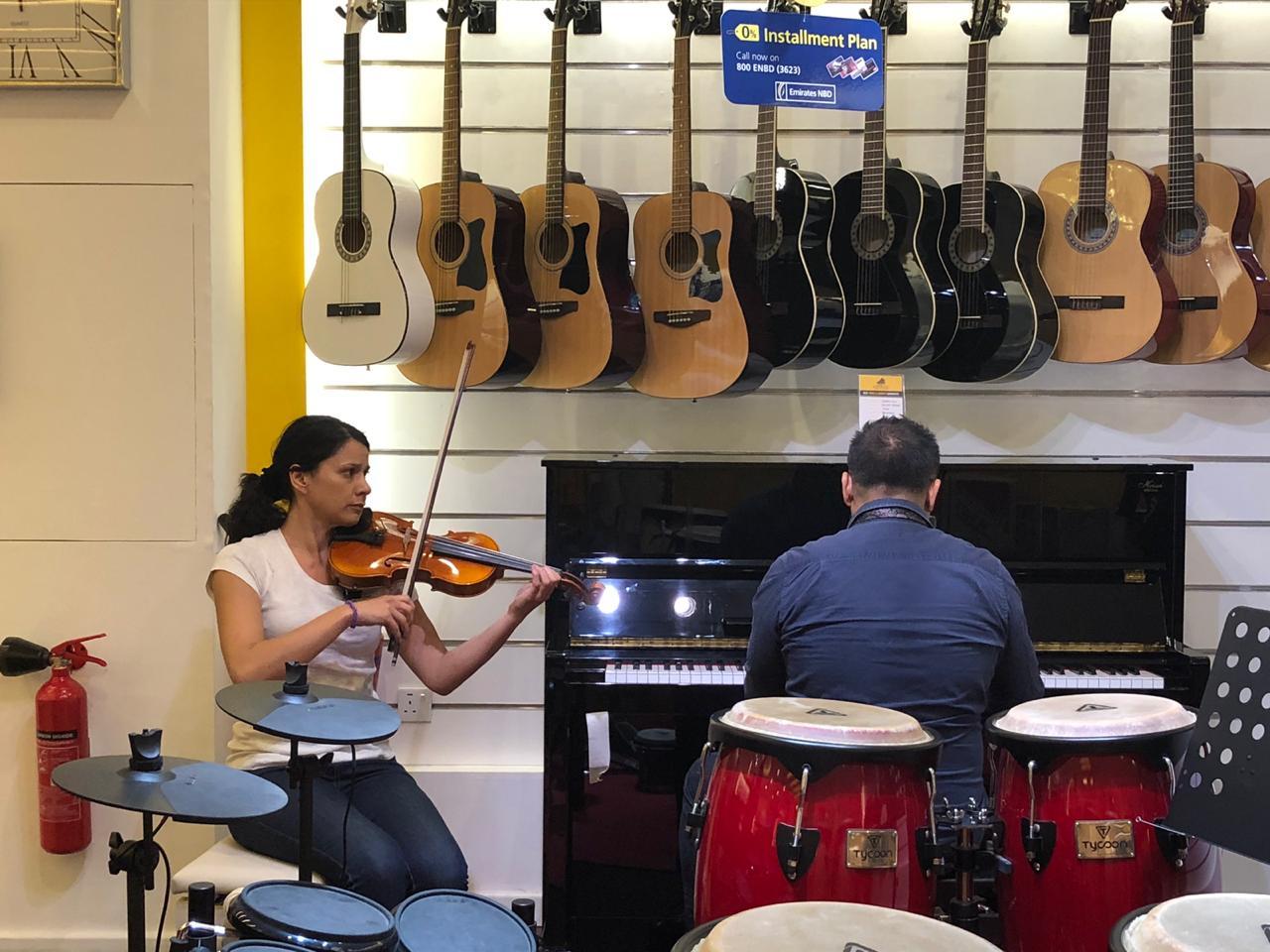 violin and piano classes in Dubai - Melodica Music center Palm branch