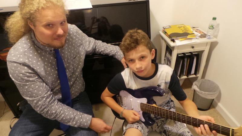 guitar lessons melodica music center dubai