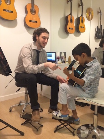 guitar lessons at melodica music school in dubai
