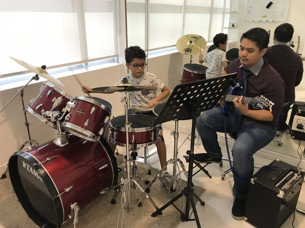 Guitar and drums played together - Drums classes in Dubai