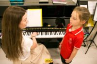 Melodica Vocal Teacher with her student - Melodica.ae